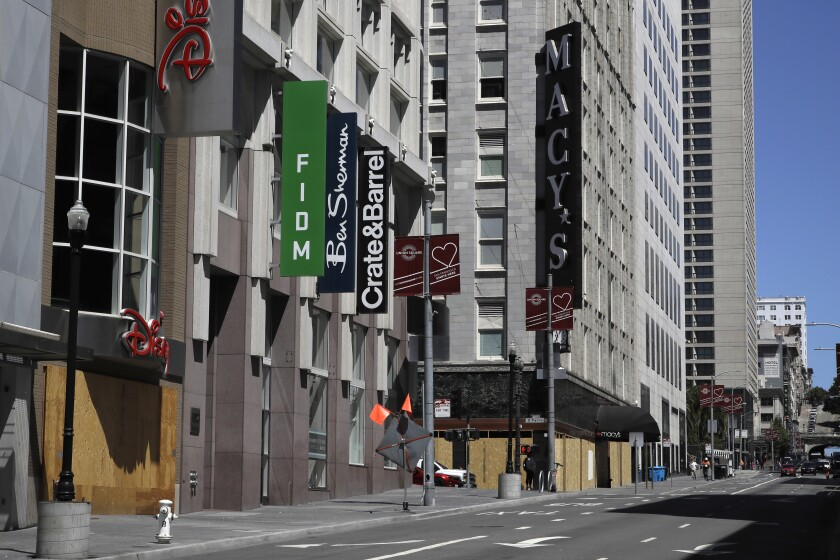 Closed businesses are seen in downtown San Francisco.