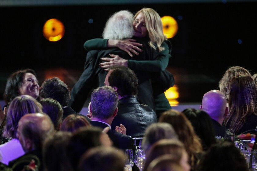 """Laura Dern embraces her father, Bruce Dern, after winning the SAG Award for her supporting role in """"Marriage Story."""""""