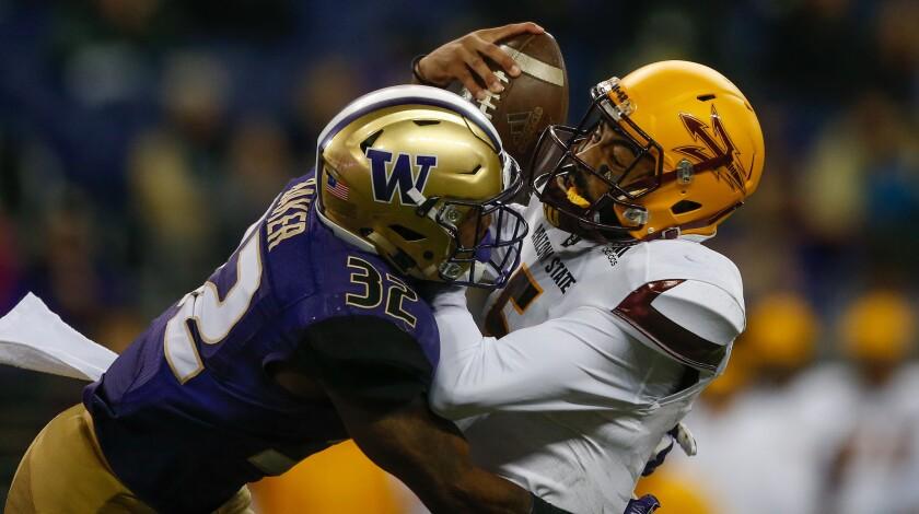 Washington's Budda Baker sacks Arizona State quarterback Manny Wilkin on Nov. 19.
