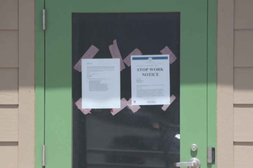 The Stop Work Notice is posted on the Children's Pool lifeguard tower door.