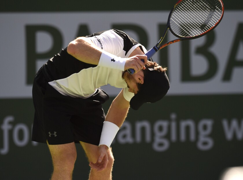 Andy Murray reacts after losing a point against Federico Delbonis during their third round match at the BNP Paribas Open in Indian Wells.
