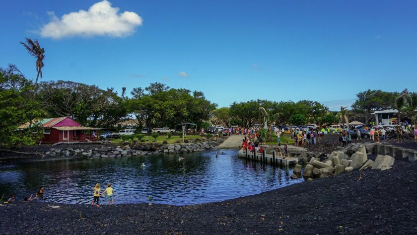 The new black sand beach was created when hot lava met ocean water.