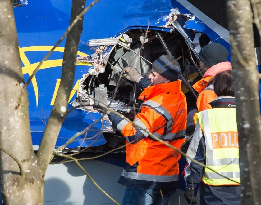 Police inspect the wreckage of a train near Bad Aiblling, southern Germany, Friday Feb. 12, 2016.  Police in southern Germany said Friday  a third black box has been recovered from the wreck of two trains involved in a fatal head-on crash Tuesday. More than ten people died and scores were injured,