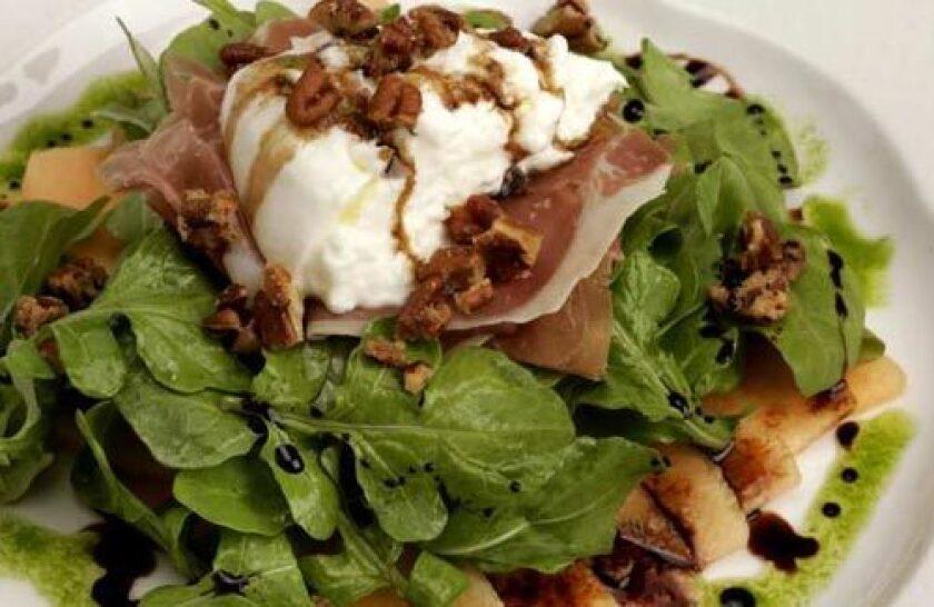 Murano's burrata salad with arugula also pairs prosciutto and melon.