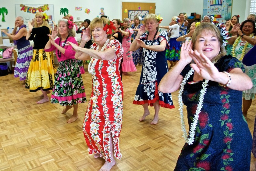Christinia Pualani Lee's Hawaiian dance class practicing at the Carlsbad Senior Center.<br>