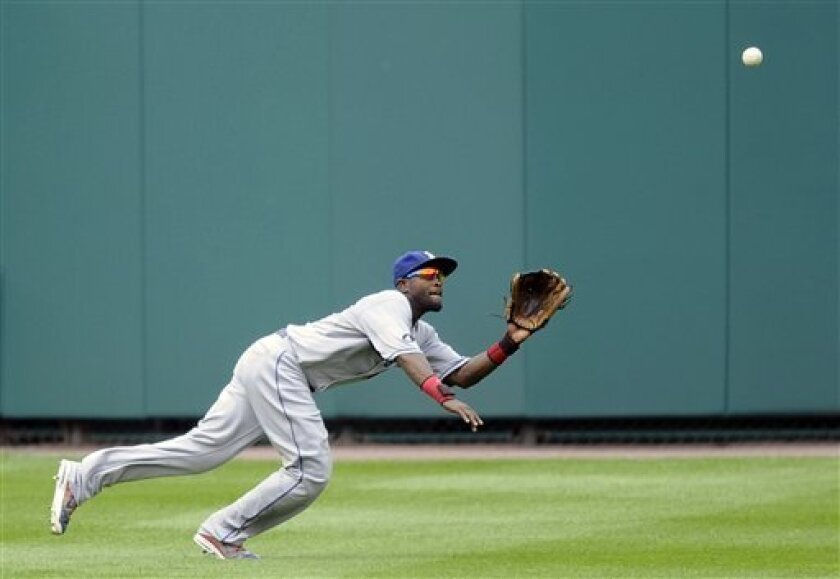 Los Angeles Dodgers left fielder Tony Gwynn Jr., chases a line drive by Washington Nationals' Jayson Werth during the third inning of a baseball game, Monday, Sept. 5, 2011, in Washington. Gwynn Jr. made the catch on the play for the out. (AP Photo/Nick Wass)