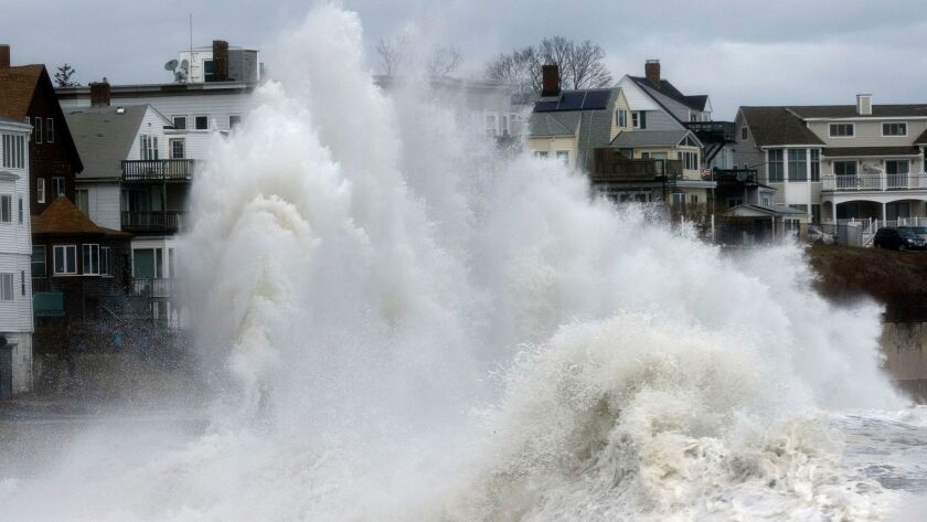 A large wave crashes into a seawall in Winthrop, Mass., Saturday, March 3, 2018, a day after a nor'e