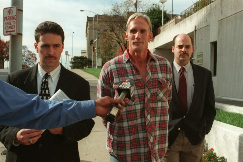 Wesley Ira Purkey is escorted by police officers in Kansas City, Kan., after his arrest in 1998.