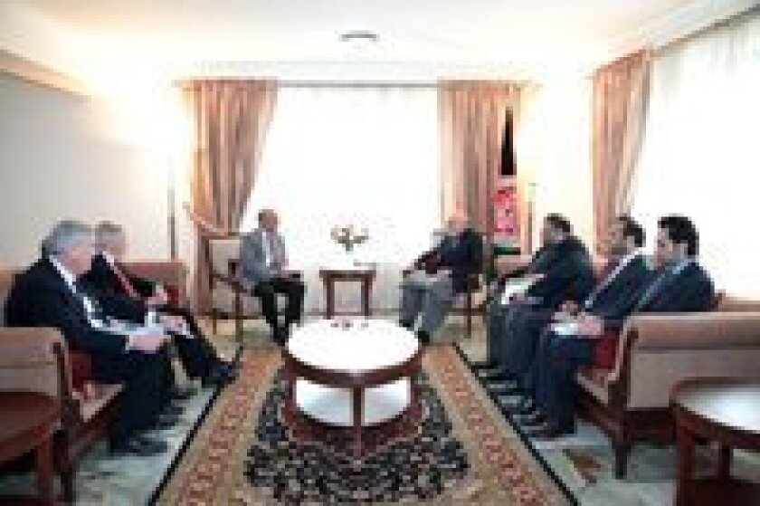 Steve Brown (far left) joins Rotary International President Kalyan Banjaree of India (left center) in a meeting with Afghanistan President Hamid Karzai (right center). Brown, of Del Mar, helped facilitate the meeting, which focused on eradicating polio.