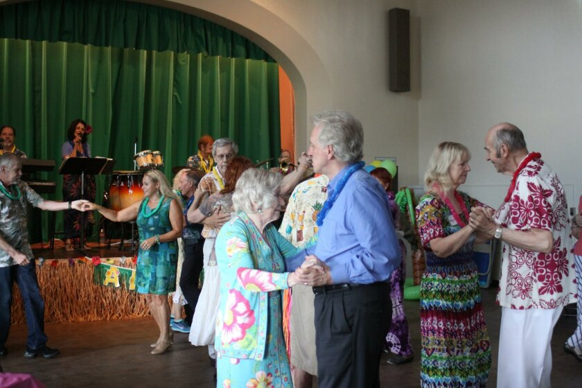 The main hall of La Jolla Rec Center fills with dancing seniors.