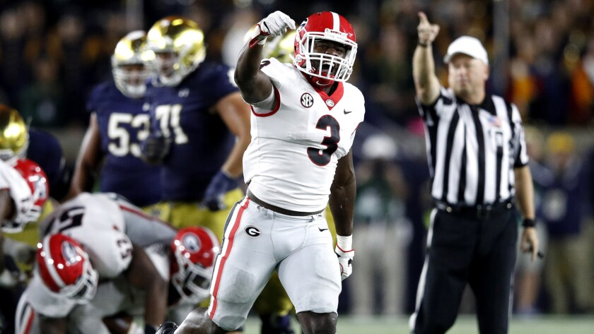 Georgia's Roquan Smith (3) celebrates after a fumble recovery by a teammate in the fourth quarter against Notre Dame at Notre Dame Stadium on Sept. 9, 2017 in South Bend, Ind. Georgia won 20-19.