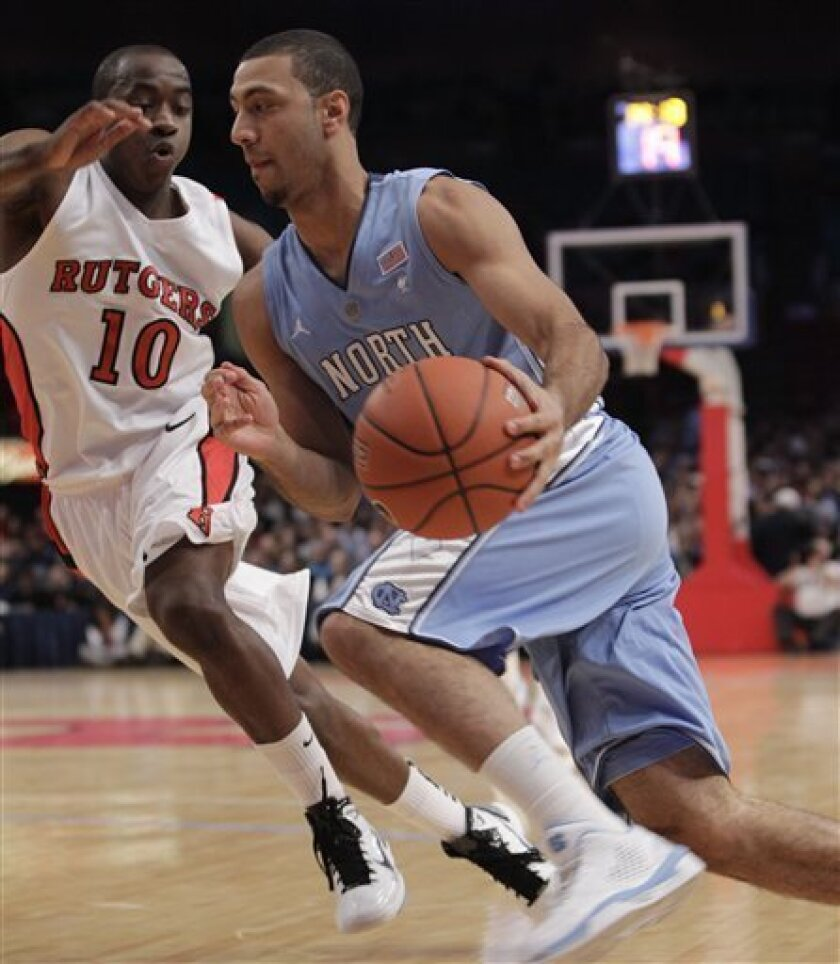 North Carolina guard Leslie McDonald (2) drives toward the basket with Rutgers guard James Beatty (10) defending in the first half of an NCAA college basketball game at Madison Square Garden in New York, Tuesday, Dec. 28, 2010.  (AP Photo/Kathy Willens)