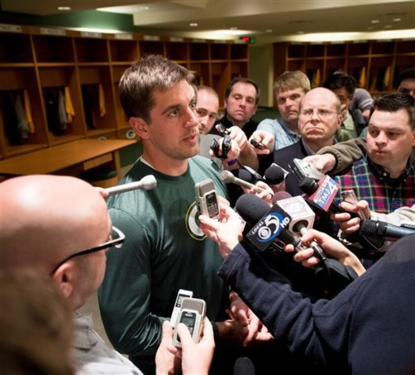 Green Bay Packers quarterback Aaron Rodgers answers questions from the media inside the locker room at Lambeau Field on Friday, April 26, 2013, in Green Bay, Wis., after the announcement of his contract extension with the NFL football team. (AP Photo/The Green Bay Press-Gazette,  Lukas Keapproth) N