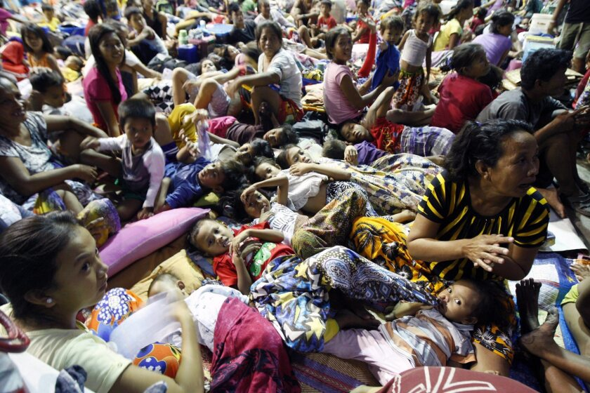 Residents take shelter inside a gymnasium in Mambaling village in the central Philippines ahead of a typhoon.