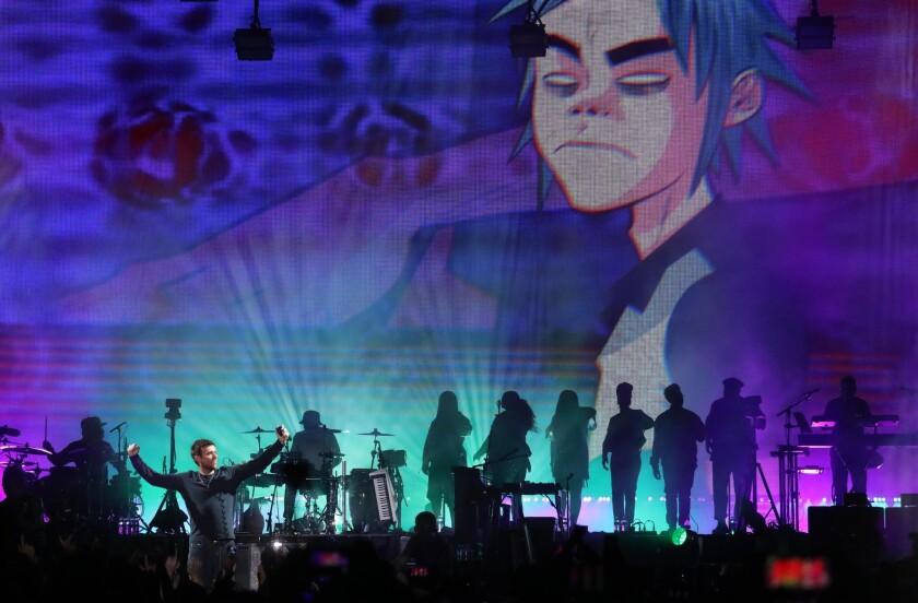 Damon Albarn performs with Gorillaz during Saturday's Demon Dayz festival at the Pico Rivera Sports Arena.