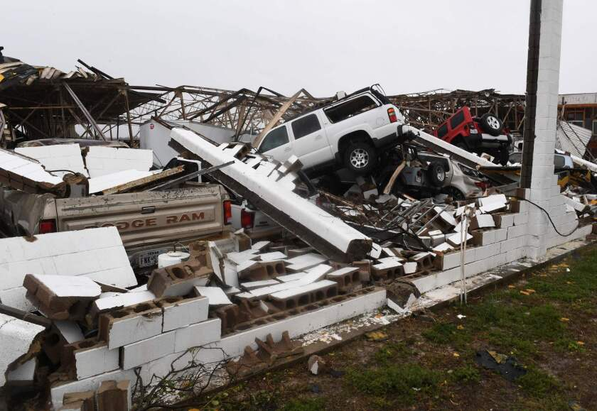 Vehicles sit beneath a destroyed building at Rockport Airport after Hurricane Harvey came ashore in