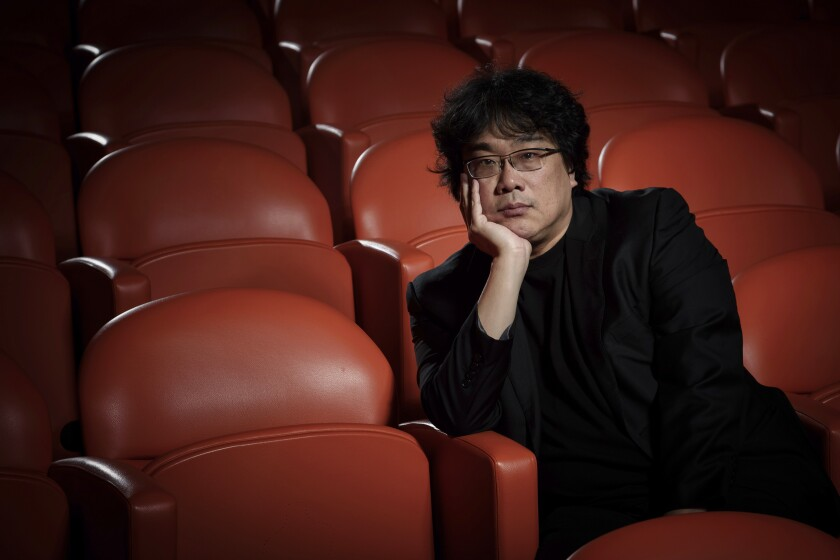 "This Oct. 8, 2019 photo shows filmmaker Bong Joon-Ho posing for a portrait at the Whitby Hotel screening room in New York to promote his film ""Parasite."" The film will open in theaters Friday having already amassed $70.9 million in Bong's native South Korea. In May, ""Parasite"" won the Palme d'Or at the Cannes Film Festival, a first for a Korean film. (Photo by Christopher Smith/Invision/AP)"