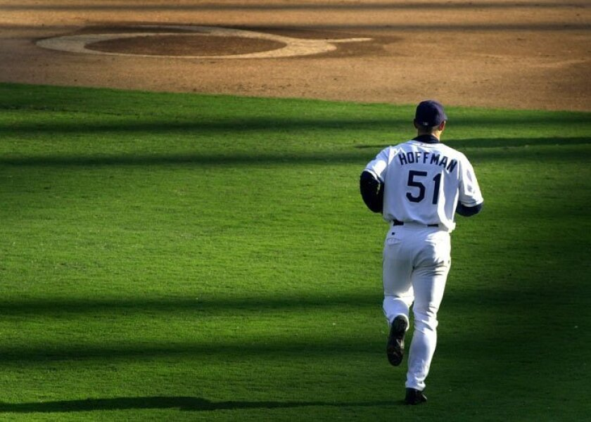 Trevor Hoffman runs to the mound to pitch in the last inning of the Padres' last game at Qualcomm Stadium, Sept. 28, 2003.