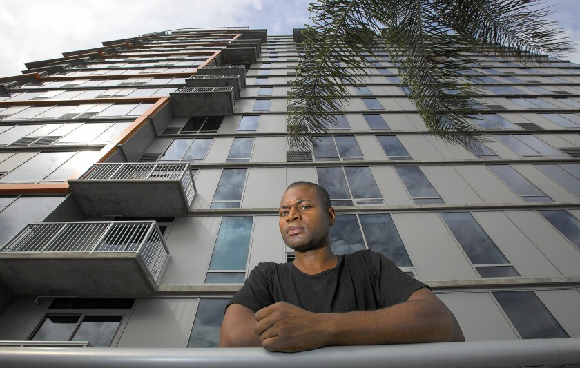 """Odain Watson pays $2,295 for a one-bedroom unit in the Sunset and Gordon complex. """"You would never think a company of this caliber and a building of this size would be so unprofessionally managed,"""" he says."""