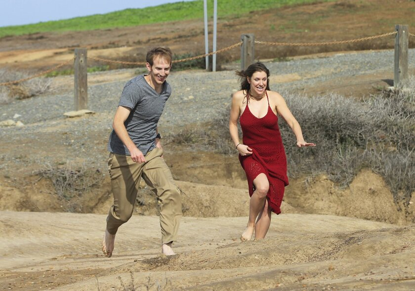 "Tom Dugdale and Jenni Putney of The Trip rehearse for an ""Orpheus & Eurydice"" video shoot on the bluffs near the Torrey Pines Gliderport."