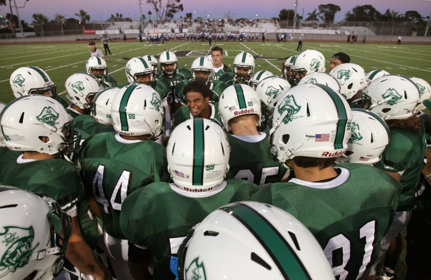Oceanside High School's team meets on field before the kickoff again Mira Mesa Sept. 12, 2012.