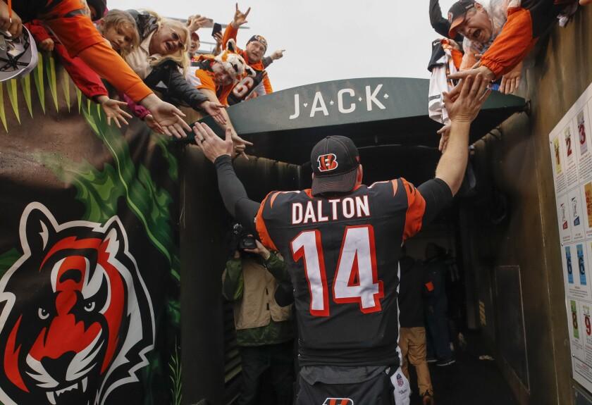 Cincinnati Bengals quarterback Andy Dalton greets fans as he walks to the locker room.