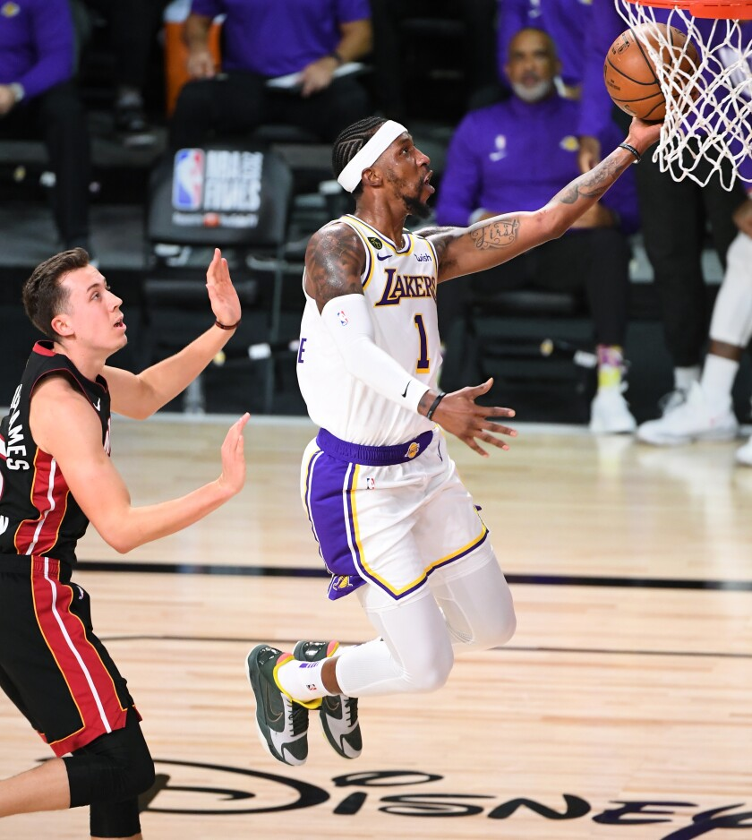 Kentavious Caldwell-Pope beats Miami's Duncan Robinson for a layup during the Lakers' title-clinching win on Oct. 11, 2020.