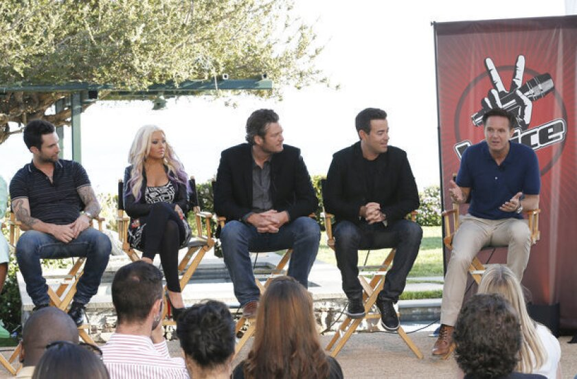 "'The Voice' coaches Adam Levine, left, Christina Aguilera and Blake Shelton, host Carson Daly and producer Mark Burnett at a news conference in Malibu for the singing competition series ""The Voice."""