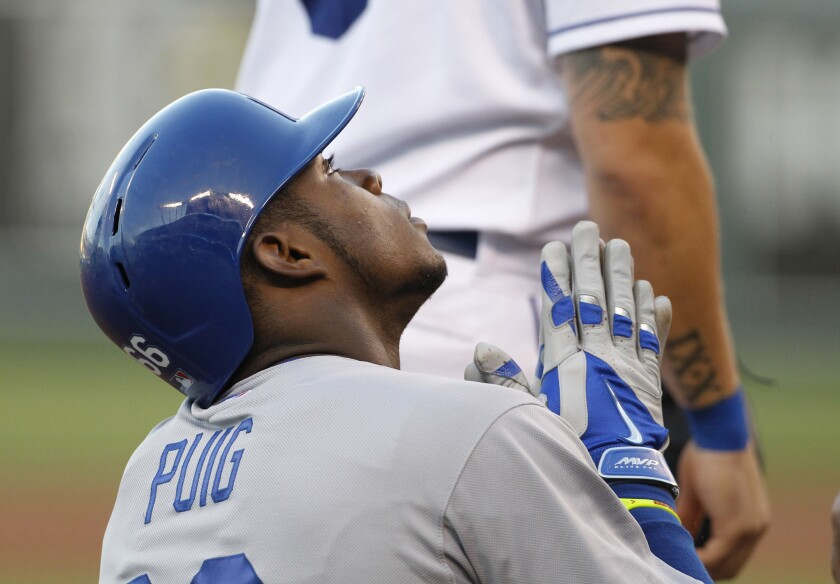 Dodgers' Yasiel Puig reacts after hitting a triple in the third inning of a game against the Kansas City Royals on Wednesday.
