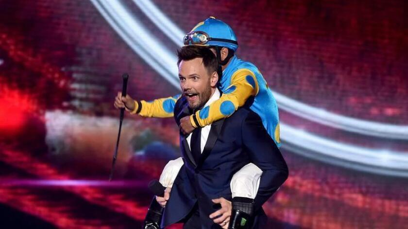 Comedian Joel McHale, left, and jockey Victor Espinoza walk onstage during the 2015 ESPYS at Microsoft Theater on July 15 in Los Angeles. McHale will perform at KAABOO. (/ Photo by Kevin Winter / Getty Images)
