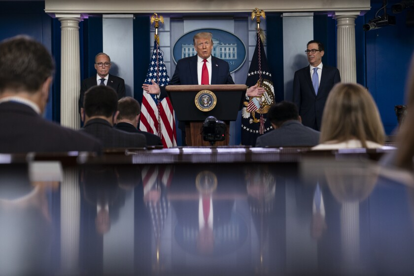 President Trump speaks at a July 2 White House news briefing, with Larry Kudlow, left, and Steven Mnuchin.