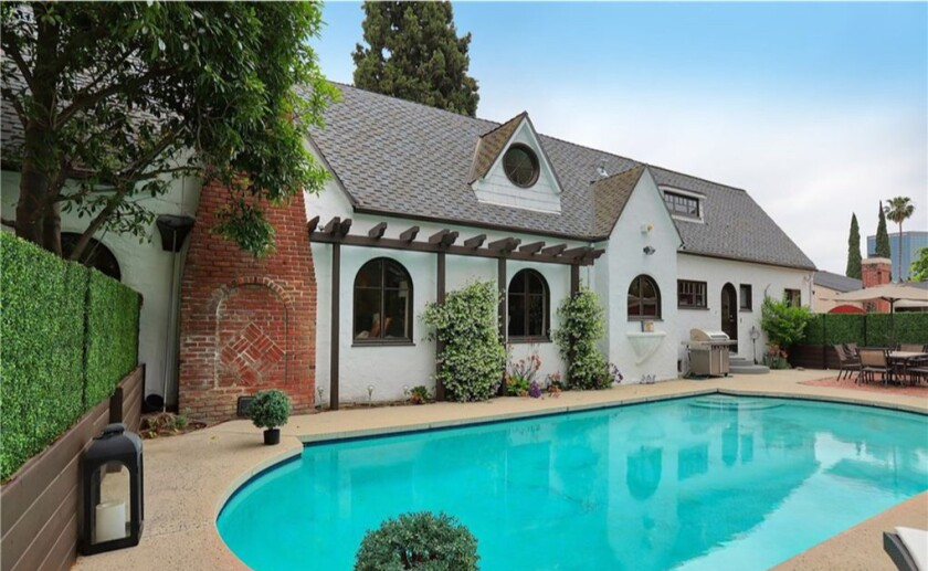 Outside of Robbie Amell and Italia Ricci's North Hollywood Tudor home with swimming pool.