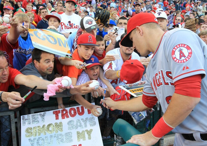 Mike Trout signs autographs for some fans Tuesday in Philadelphia before the Angels played the Phillies.