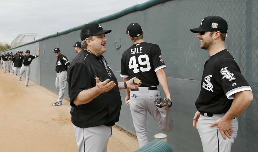 Chicago White Sox's David Robertson talks to pitching coach Don Cooper, left, during a spring training baseball workout Friday, Feb. 19, 2016, in Glendale, Ariz. (AP Photo/Morry Gash)