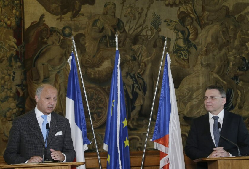French Foreign Minister Laurent Fabius, left, and his counterpart from Czech Republic Lubomir Zaoralek hold a press conference in Prague, Czech Republic, Sunday, Aug. 23, 2015. Fabius is on a two day visit of the Czech Republic. (AP Photo/Petr David Josek)