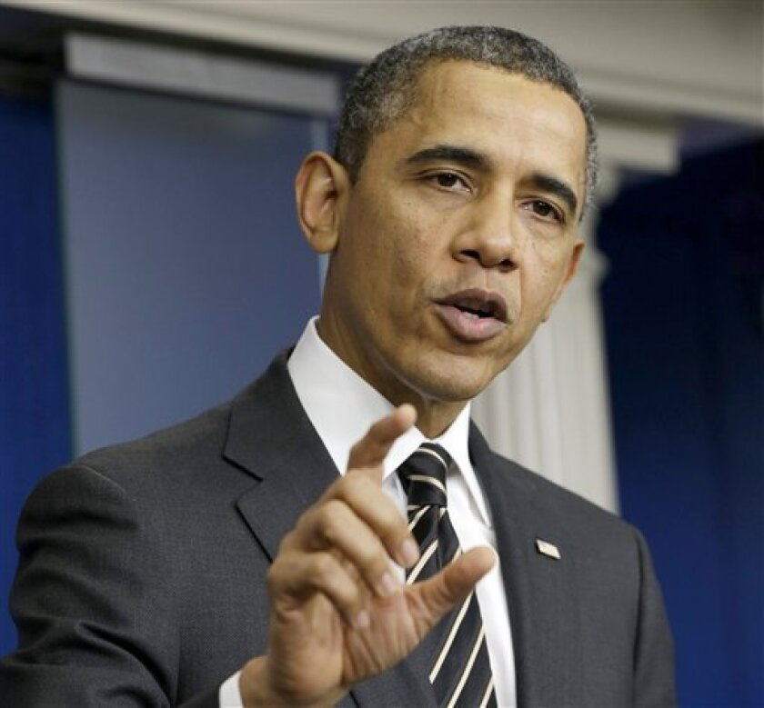 FILE - In this Feb. 5, 2013 file photo, President Barack Obama gestures as speaks in the James Brady Press Briefing Room of the White House in Washington. The president's announcement that half of the U.S. troops now in Afghanistan will come home within one year will put the number precisely where