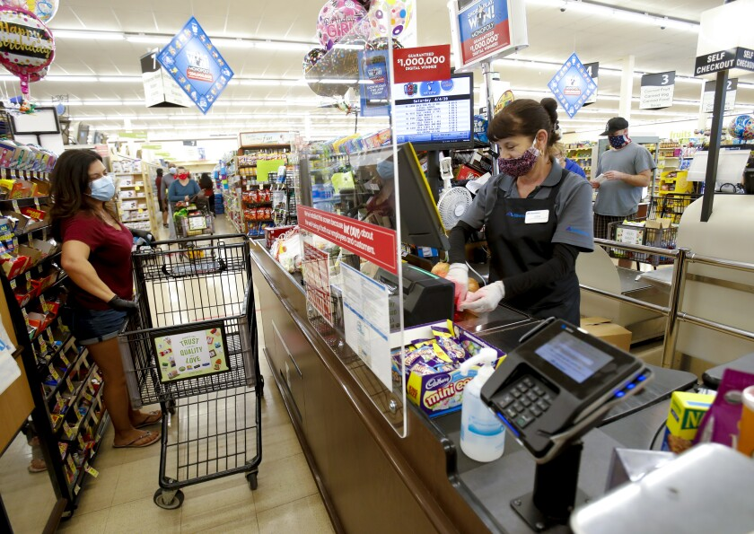 All employees at grocery stores are required to wear a covering over their face.
