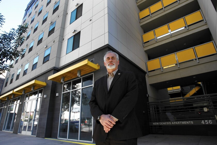 Robert Newman, property supervisor for Skid Row Housing Trust, stands in front of the New Genesis Apartments in downtown Los Angeles. The housing trust's application for an alcohol permit for a restaurant on the premises has mushroomed into a symbolic fight for the soul of skid row.