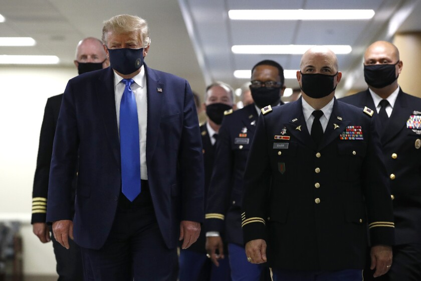 President Trump wears a mask in public for the first time.