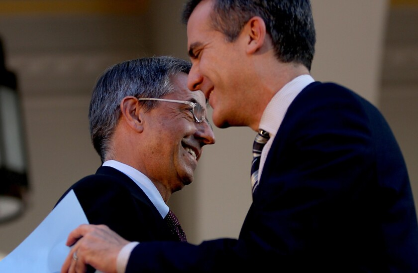 Federal officials said Wednesday that more than 35,000 people in California signed up for health insurance. Above, Los Angeles Mayor Eric Garcetti congratulates Covered California executive Peter Lee during the launch of the Affordable Care Act marketplace Oct. 1