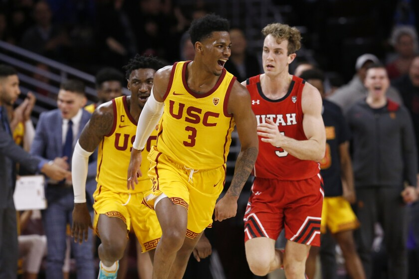 USC guard Elijah Weaver (3) celebrates after scoring a basket putting the Trojans in the lead against Utah in the second half at the Galen Center on Thursday.