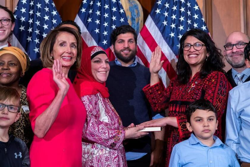 Democratic Representative from Michigan Rashida Tlaib (2-R), participates in a ceremonial swearing-in photograph with Democratic Speaker of the House Nancy Pelosi (2-L), during the first day of the 116th Congress at the US Capitol in Washington, DC, USA, 03 January 2019. EPA/EFE