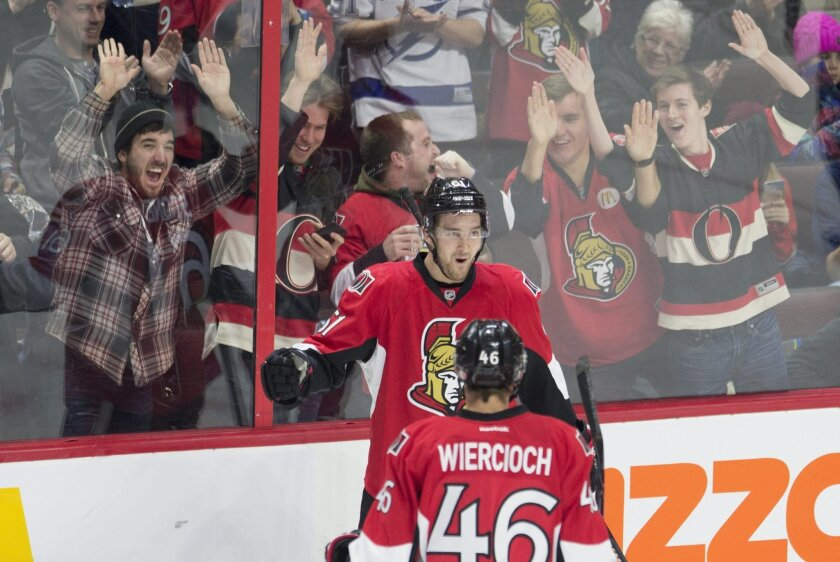 Fans react as Ottawa Senators right wing Mark Stone celebrates his second goal during second period NHL action against the Tampa Bay Lightning in Ottawa, Canada, Monday, Feb. 8, 2016. (Adrian Wyld/The Canadian Press via AP) MANDATORY CREDIT