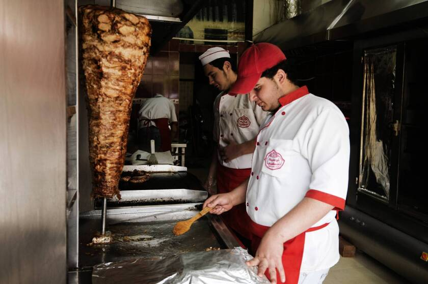 Refugees from Syria work at a restaurant on the outskirts of Cairo. As of July 8, more than 70,000 Syrians had registered with the Egypt office of the United Nations refugee agency.