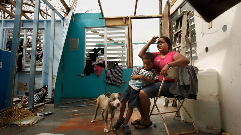 Heydee Perez, age 29, and her son, Yeriel Calera, age 4, in their devastated home in San Isidro, Puerto Rico a week after Hurricane Maria struck the island.