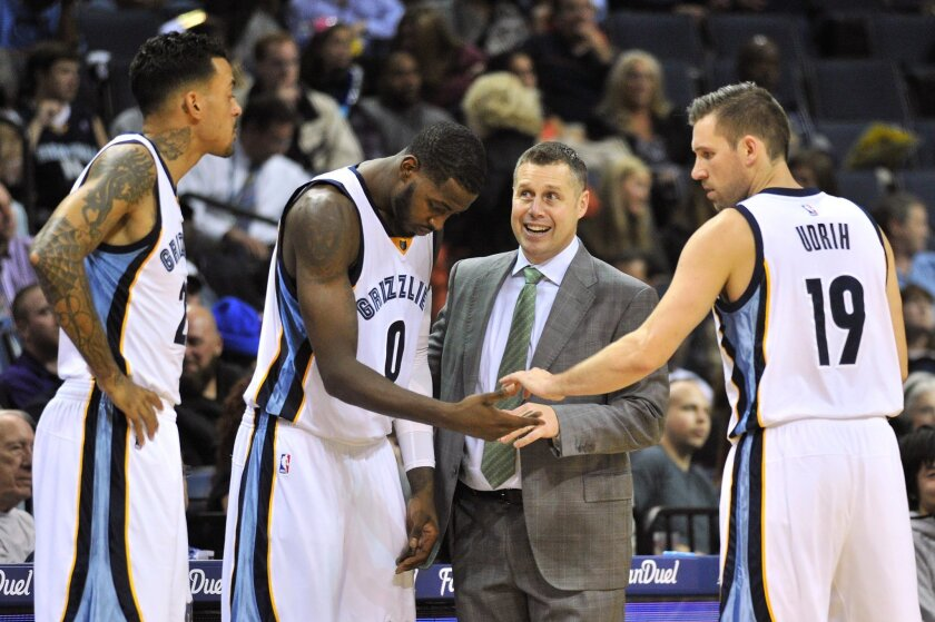 Memphis Grizzlies head coach David Joerger, second from right, talks with forwards Matt Barnes, left, and JaMychal Green (0) and guard Beno Udrih (19) in the first half of an NBA basketball game against the Brooklyn Nets, Saturday, Oct. 31, 2015, in Memphis, Tenn. (AP Photo/Brandon Dill)
