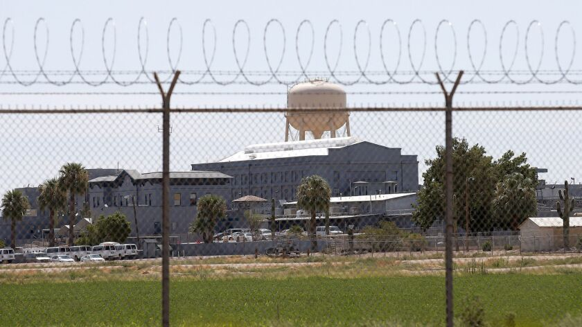 FILE - This July 23, 2014 file photo shows a state prison in Florence, Ariz. A book that discusses t
