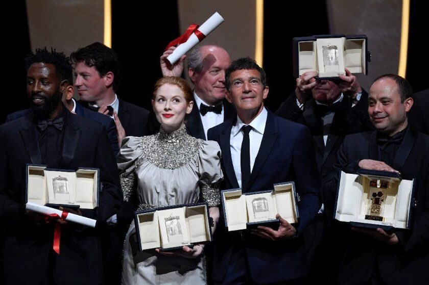 (From left) Jury Prize winner French director Ladj Ly, best actress winner British actress Emily Beecham, best director winners Belgian director Luc and Jean-Pierre Dardenne, best actor winner Spanish actor Antonio Banderas and Camera d'Or winner Cesar Diaz.