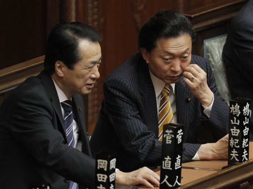 Democratic Party of Japan leader Naoto Kan, left, chats with outgoing Prime Minister Yukio Hatoyama at Parliament's lower house in Tokyo Friday, June 4, 2010. Japan's parliament installed Kan as the new prime minister Friday, handing the outspoken populist the job of rallying his party and reclaiming its mandate for change ahead of elections next month. (AP Photo/Itsuo Inouye)