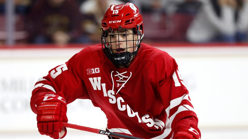 Alex Turcotte plays during a game for Wisconsin.